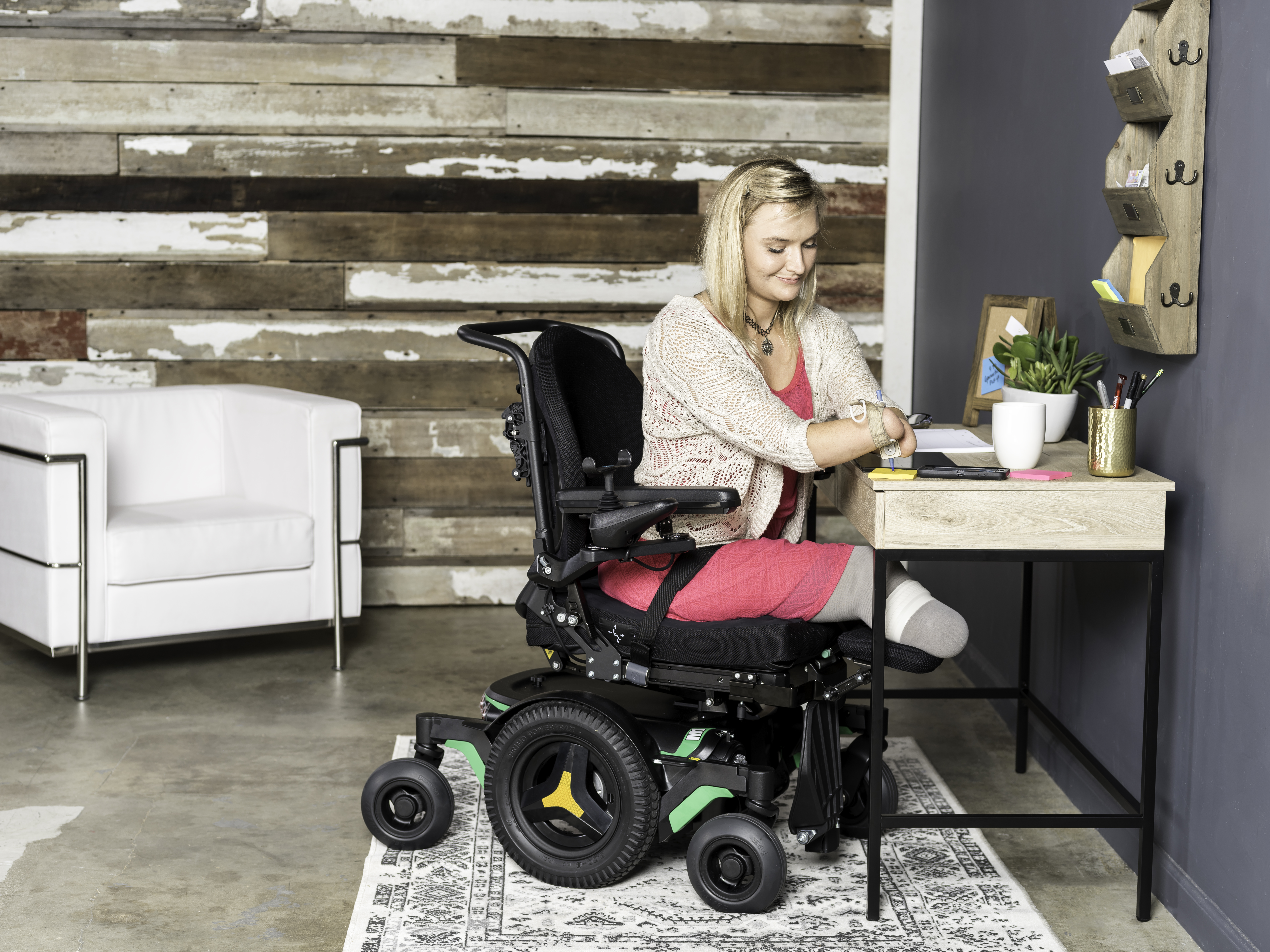 permobil m1 indoor powerchair clinical mobility solutions girl at desk