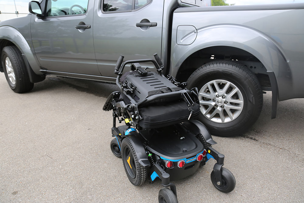 M1 powerchair in transport configuration with backrest folded down